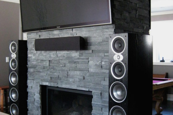 mounted television and speakers