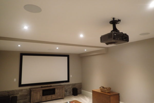 mounted tv and projector in basement